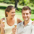 Couple eating an ice cream in the park — Stock Photo #10858977