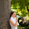 Stock Photo: Young woman drinking water