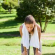 Sporty woman in the park - Stock Photo