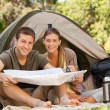 Couple camping in the park — Stock Photo