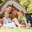 Family camping in park — Stock Photo #10859281