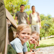 Happy family camping in the park - Stok fotoraf