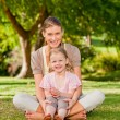 Daughter with her mother in the park — Stock Photo