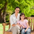 Mother and her daughter on the bench - Stock Photo