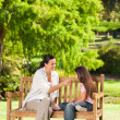Cute girl with her mother in the park — Stock Photo