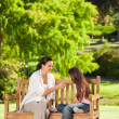 Cute girl with her mother in the park — Stock Photo #10859650