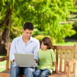 Stockfoto: Son with his father looking at their laptop