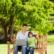 Stockfoto: Father with his son looking at their laptop