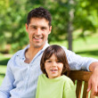 Son with his father on the bench — Stock Photo #10859754