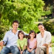Family on the bench — Stock Photo