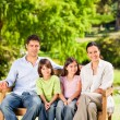 Family on the bench — Stock Photo #10859780