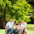Family on the bench - Stock Photo