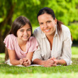 Stock Photo: Mother with her daughter lying down