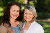 Mother with her daughter looking at the camera in the park — Stock Photo