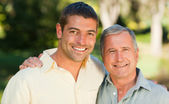 Father with his son looking at the camera in the park — Stock Photo