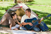 Father playing guitar with his son — Stock Photo