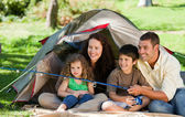 Joyful family fishing — Stock Photo