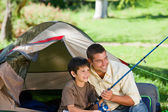 Son fishing with his father — Stock Photo