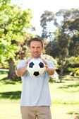 Handsome man with a ball — Foto Stock