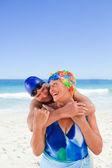 Happy elderly couple on the beach — Stock Photo