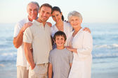 Portrait of a smiling family at the beach — Stock Photo
