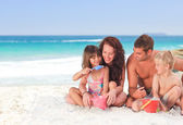 Portrait of a family at the beach — Stock Photo