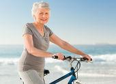 Senior woman with her bike — Stock Photo