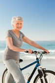 Senior woman with her bike — Stock Photo