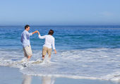 Lovely couple in the sea — Stock Photo