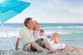 Mature couple on the beach — Stock Photo