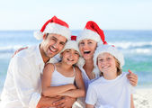 Family during Christmas day at the beach — Stock Photo