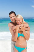 Enamored couple on the beach — Stock Photo
