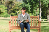 Man making his crossword — Stock Photo