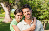 Daughter with her father in the park — Stock Photo