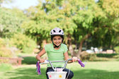 Little girl with her bike — Photo
