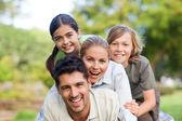 Happy family in the park — Stock Photo