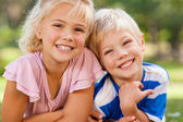 Boy with his sister in the park — Stock Photo