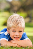 Boy lying down in the park — Stock Photo