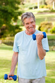 Mature man doing his exercises in the park — Stok fotoğraf