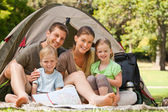 Family camping in the park — Stock Photo