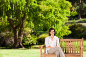Brunette woman on the bench — Stock Photo
