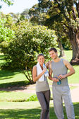 Sporty lovers in the park — Stock Photo