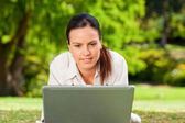 Young woman working on her laptop — Stock Photo