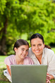 Mother and her daughter looking at their laptop — Stock Photo