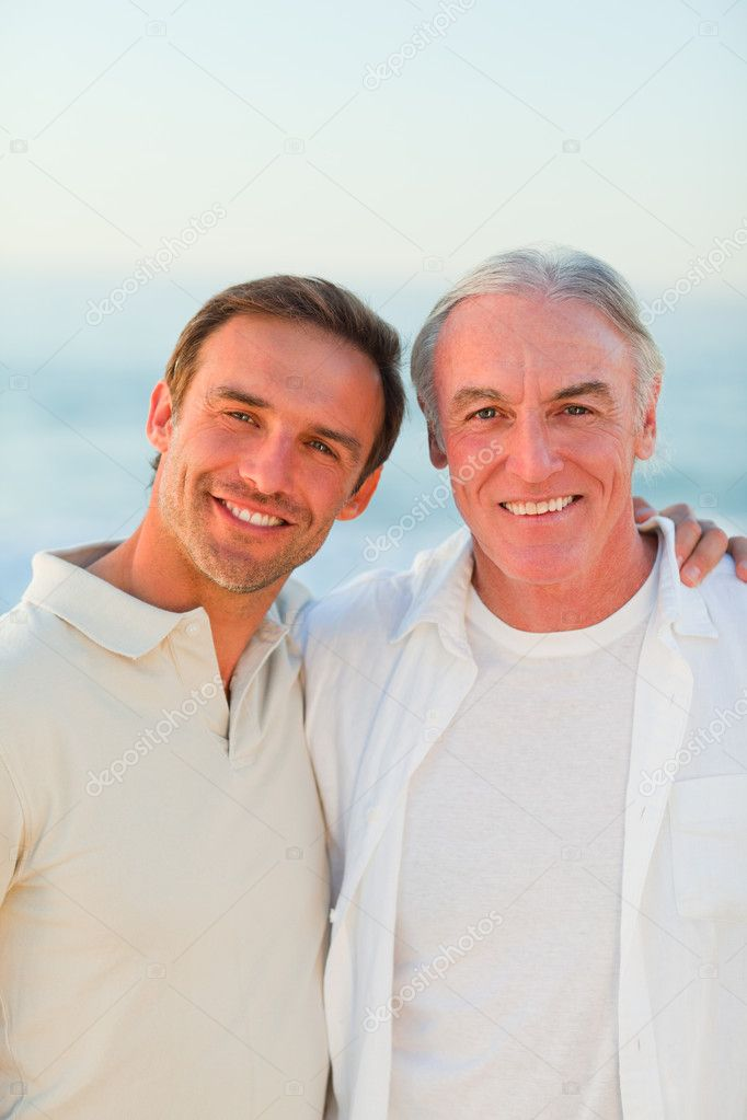 Father with his son at the beach  Stock Photo #10853765
