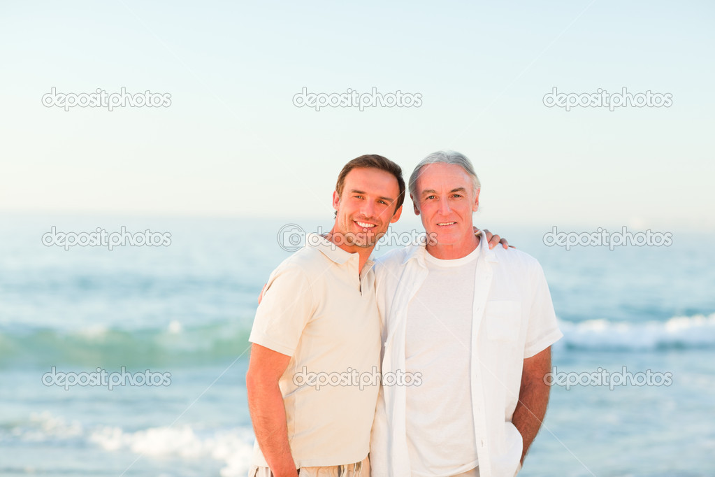 Father with his son at the beach  Stock Photo #10853768