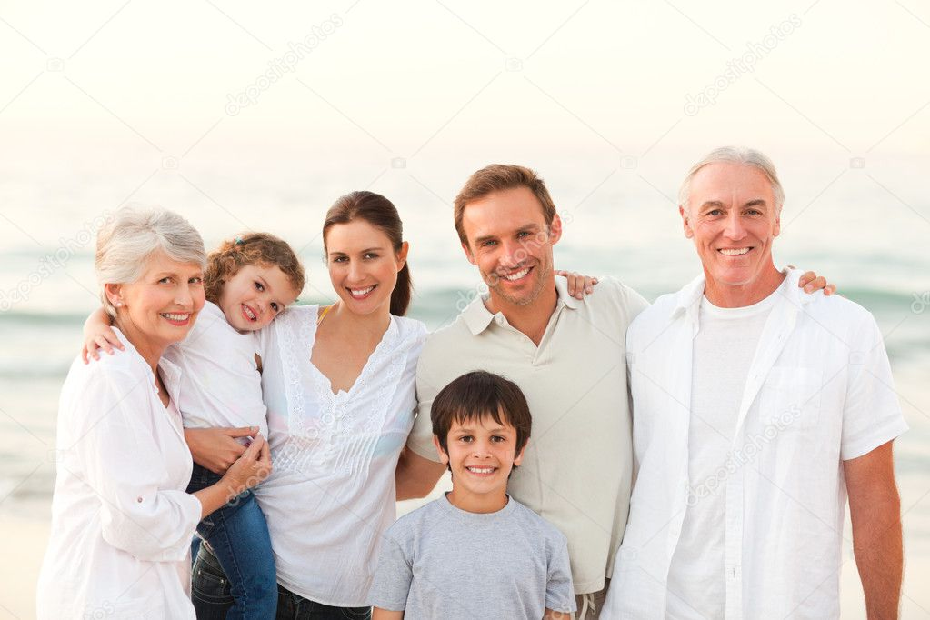 Beautiful family at the beach — Stock Photo #10853783