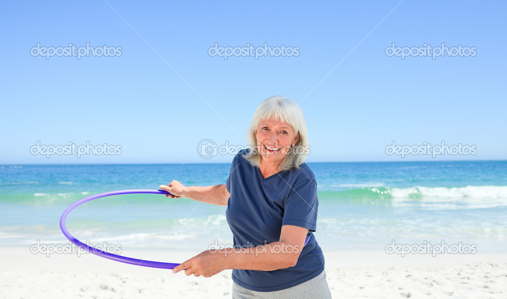 Senior woman playing with her hoop — Stock Photo #10853801