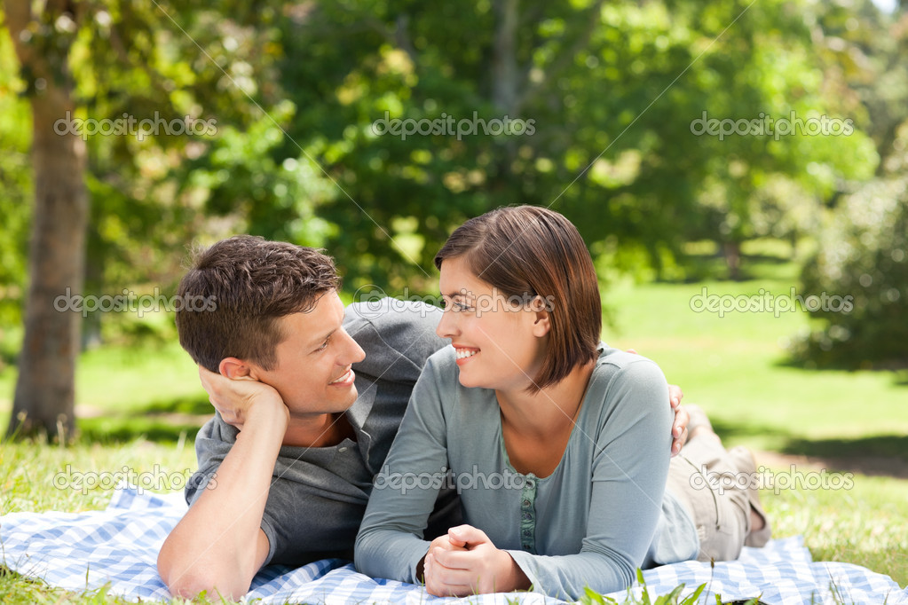 Couple lying down in the park  Stock Photo #10856659