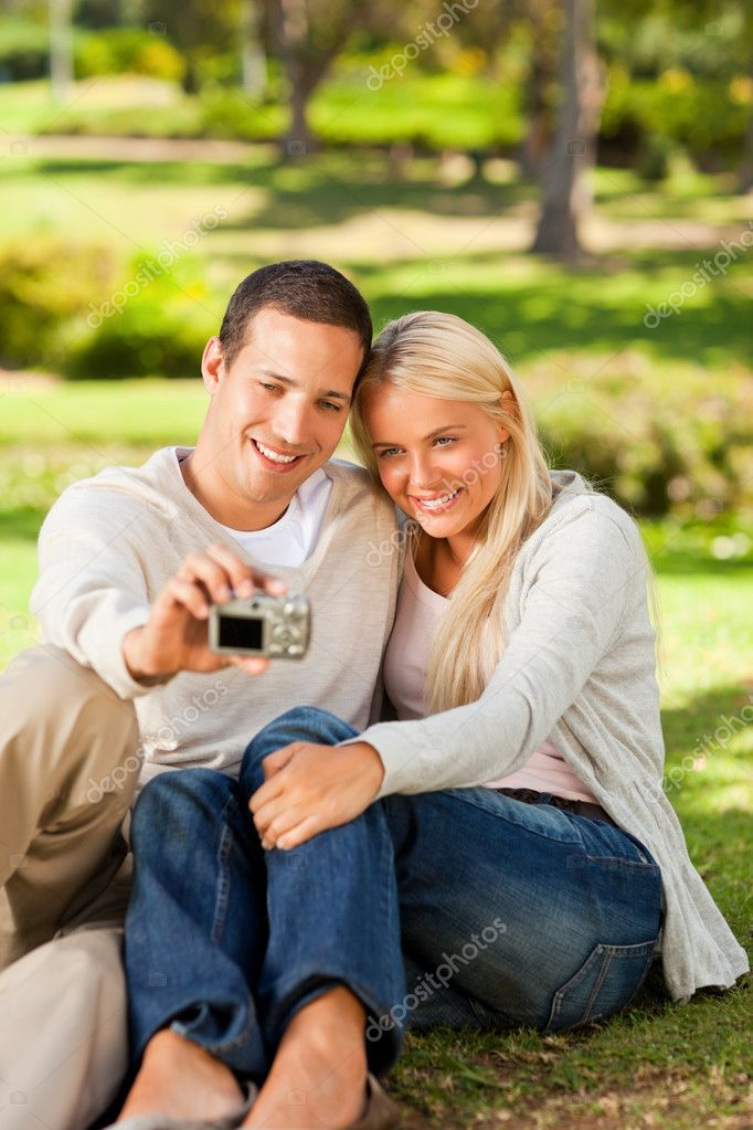 Young couple taking a photo of themselves — Stock Photo #10857458